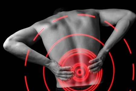32971296 - acute pain in a male lower back, monochrome  image, pain area of red color